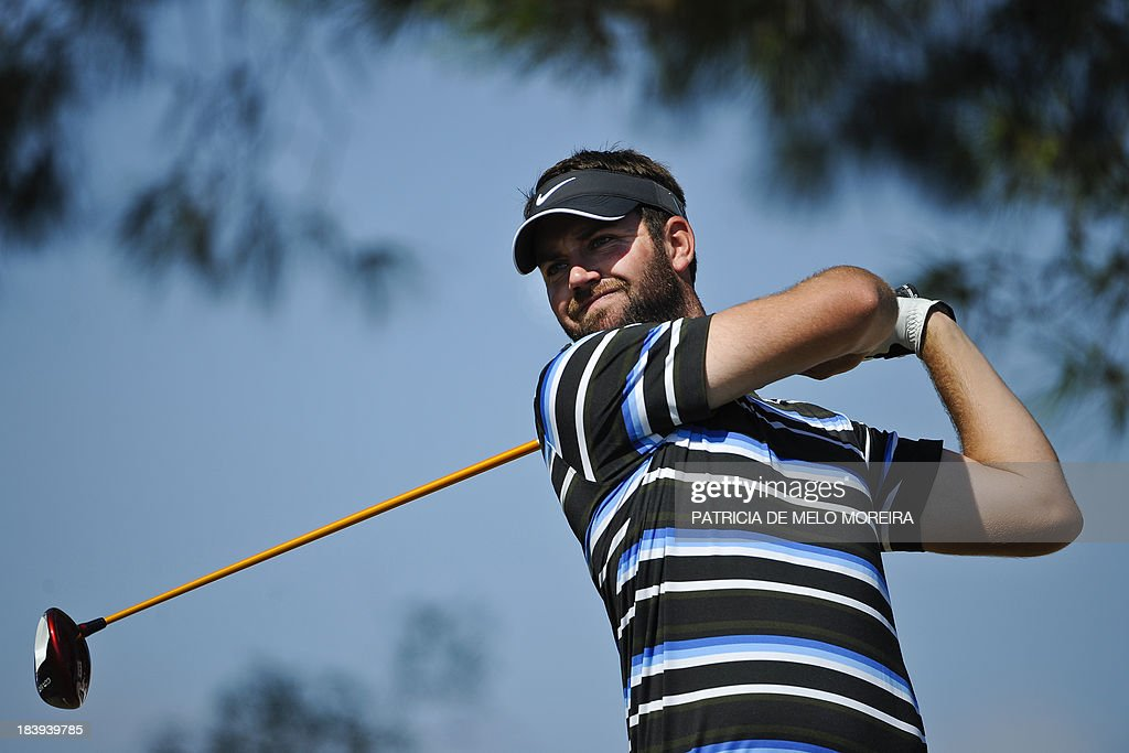 Scottish golfer Scott Jamieson tees off for the 9th hole during the first day of the Portugal Masters golf tournament at Victoria Golf Course in...