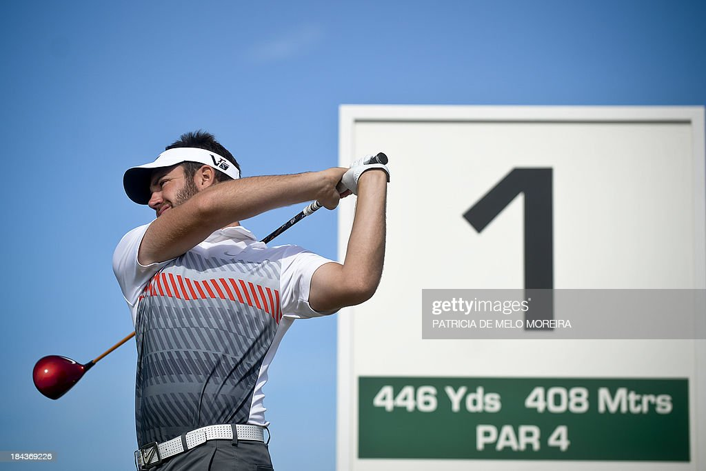 Scottish golfer Scott Jamieson warms up at the 1st hole during the last day of the Portugal Masters golf tounament at Victoria Golf Course in...