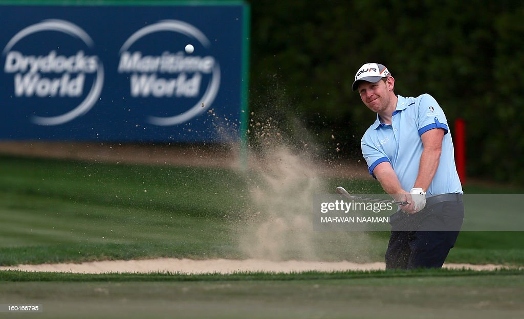 Scottish golfer Stephen Gallacher plays a shot during the second round of the Dubai Desert Classic golf tournament in the Gulf emirate of Dubai on February 1, 2013. AFP PHOTO/MARWAN NAAMANI