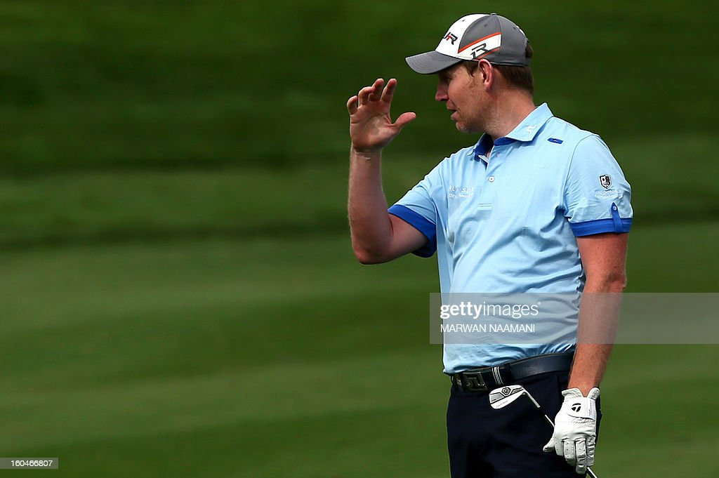Scottish golfer Stephen Gallacher reacts after playing a shot during the second round of the Dubai Desert Classic golf tournament in the Gulf emirate of Dubai on February 1, 2013. AFP PHOTO/MARWAN NAAMANI