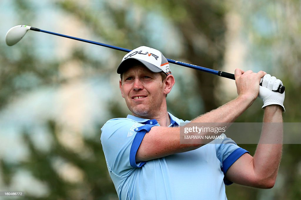 Scottish golfer Stephen Gallacher tees-off during the second round of the Dubai Desert Classic golf tournament in the Gulf emirate of Dubai on February 1, 2013. AFP PHOTO/MARWAN NAAMANI