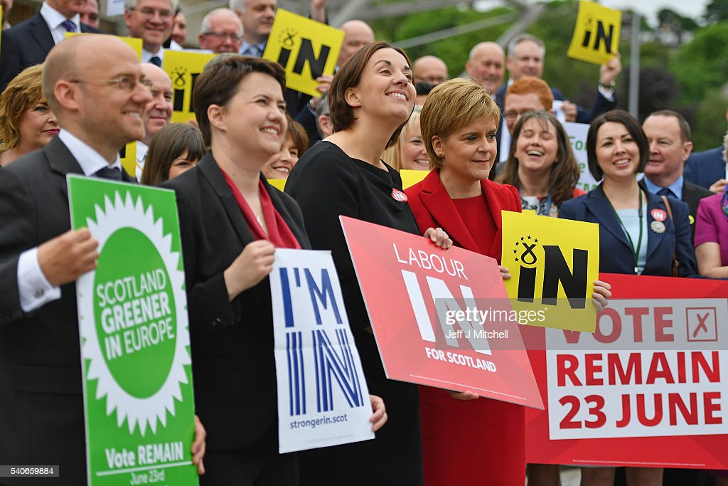 Scottish Green Party co-convener Patrick Harvie, Ruth Davidson leader of Scottish Conservatives, Kezia Dugdale leader of Scottish Labour and Scottish First Minister, Nicola Sturgeon pose with supporting MSPs as they gather outside the Scottish Parliament with vote remain EU banners on June 16, 2016 in Edinburgh, Scotland. With one week to go before the EU referendum on June 23rd campaigning by the 'In' and 'Out' campaigns are stepping up a gear.