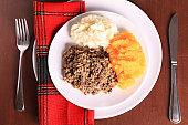 Scottish Haggis Table Setting For A Burns Night Dinner With A Royal Stuart Tartan Napkin