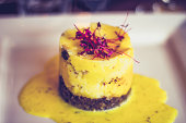 Haggis, the national dish of Scotland. Arranged on a plate with a tower of mashed potato and mustard sauce