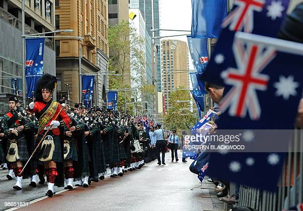 A Scottish highlands band marches in the 95th Anzac Day parade through Sydney on April 25 2010 Despite the rain spectators turned out in their...