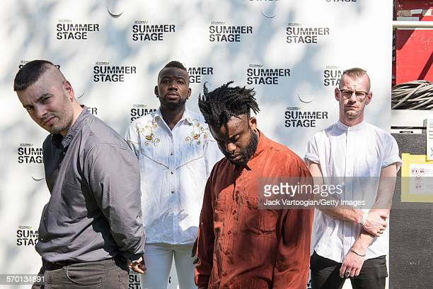 Scottish HipHop and Pop band Young Fathers poase backstage at Central Park SummerStage New York New York July 25 2015 Pictured are from left Scot 'G'...