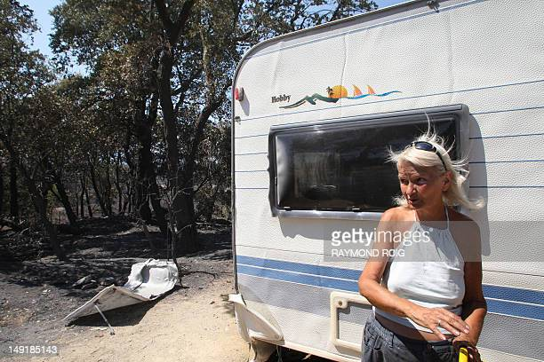 Scottish holidaymaker is pictured in front of her caravan the only one who escaped from the total destruction by fire of the Pedres camping in...