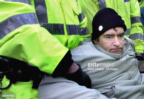 Scottish Independent MSP Tommy Sheridan is taken away from the gates of Faslane naval base on the River Clyde the home of Britain's Trident submarine...