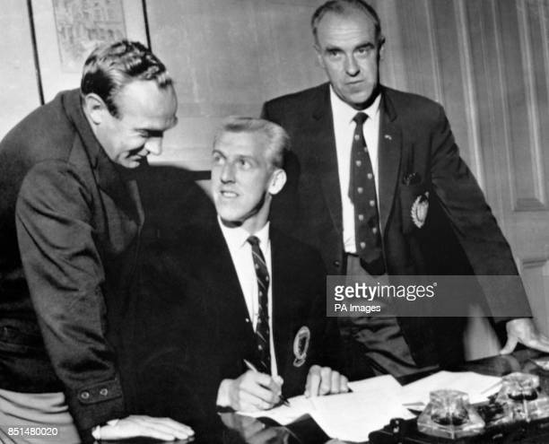 Scottish international and Dundee player Ian Ure signing for First Division Arsenal for 65000 He is watched by Arsenal manager Billy Wright and...
