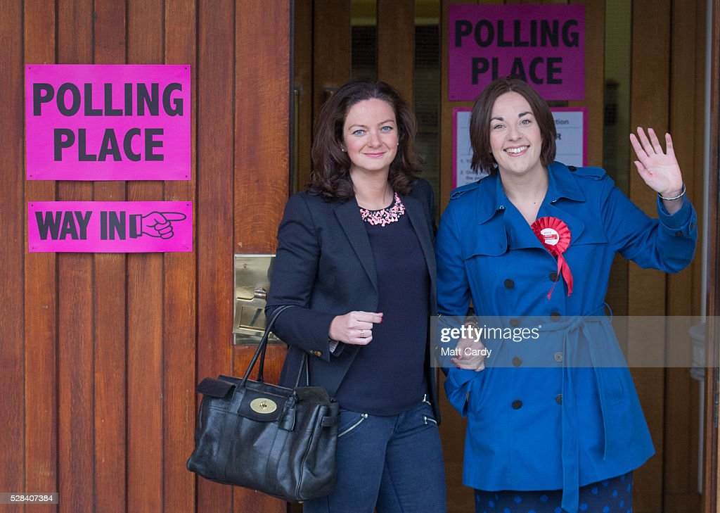 Scottish Labour Leader Kezia Dugdale (R) and her partner Louise Riddell arrives at St Ninian & Triduana RC Church to vote in the Scottish Parliament elections on May 5, 2016 in Edinburgh, Scotland. Today, dubbed 'Super Thursday', sees the British public vote in countrywide elections to choose members for the Scottish Parliament, the Welsh Assembly, the Northern Ireland Assembly, Local Councils, a new London Mayor and Police and Crime Commissioners. There are around 45 million registered voters in the UK and polling stations open from 7am until 10pm.