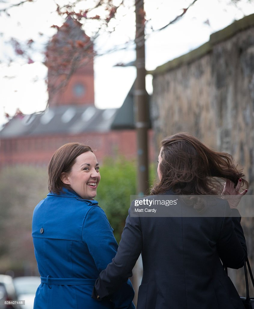 Scottish Labour Leader Kezia Dugdale and her partner Louise Riddell leave St Ninian & Triduana RC Church after voting in the Scottish Parliament elections on May 5, 2016 in Edinburgh, Scotland. Today, dubbed 'Super Thursday', sees the British public vote in countrywide elections to choose members for the Scottish Parliament, the Welsh Assembly, the Northern Ireland Assembly, Local Councils, a new London Mayor and Police and Crime Commissioners. There are around 45 million registered voters in the UK and polling stations open from 7am until 10pm.
