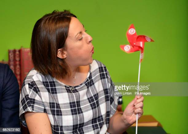 Scottish Labour leader Kezia Dugdale blows a Scottish Labour Party toy windmill on a visit to Better World Books in Dunfermline as education and...