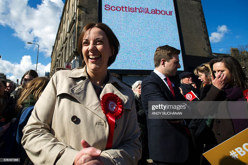 Scottish Labour leader Kezia Dugdale laughs as she unveils a new election campaign poster on Leith Walk in Edinburgh on April 30, 2015. Scotland will elect a new national assembly on May 5, 2016 with First Minister Nicola Sturgeon's pro-independence Scottish National Party looking to tighten its stranglehold on power. The Conservatives are hoping to pile on the pain for Labour in their former fiefdom by replacing them as Scotland's main opposition. / AFP / Digital / Andy Buchanan