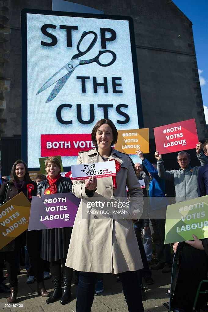 Scottish Labour leader Kezia Dugdale poses as she unveils a new election campaign poster on Leith Walk in Edinburgh on April 30, 2015. Scotland will elect a new national assembly on May 5, 2016 with First Minister Nicola Sturgeon's pro-independence Scottish National Party looking to tighten its stranglehold on power. The Conservatives are hoping to pile on the pain for Labour in their former fiefdom by replacing them as Scotland's main opposition. / AFP / Digital / Andy Buchanan