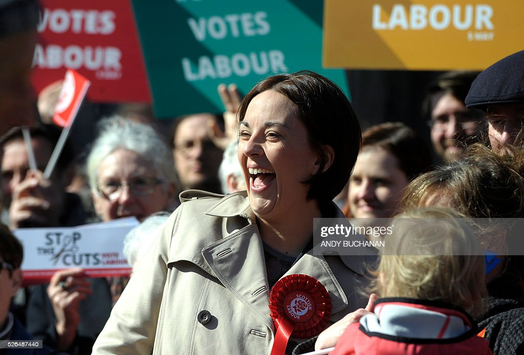 Scottish Labour leader Kezia Dugdale smiles as she unveils a new election campaign poster on Leith Walk in Edinburgh on April 30, 2015. Scotland will elect a new national assembly on May 5, 2016 with First Minister Nicola Sturgeon's pro-independence Scottish National Party looking to tighten its stranglehold on power. The Conservatives are hoping to pile on the pain for Labour in their former fiefdom by replacing them as Scotland's main opposition. / AFP / Digital / Andy Buchanan