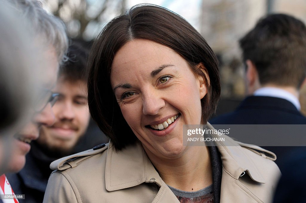 Scottish Labour leader Kezia Dugdale speaks to supporters as she unveils a new election campaign poster on Leith Walk in Edinburgh on April 30, 2015. Scotland will elect a new national assembly on May 5, 2016 with First Minister Nicola Sturgeon's pro-independence Scottish National Party looking to tighten its stranglehold on power. The Conservatives are hoping to pile on the pain for Labour in their former fiefdom by replacing them as Scotland's main opposition. / AFP / Digital / Andy Buchanan