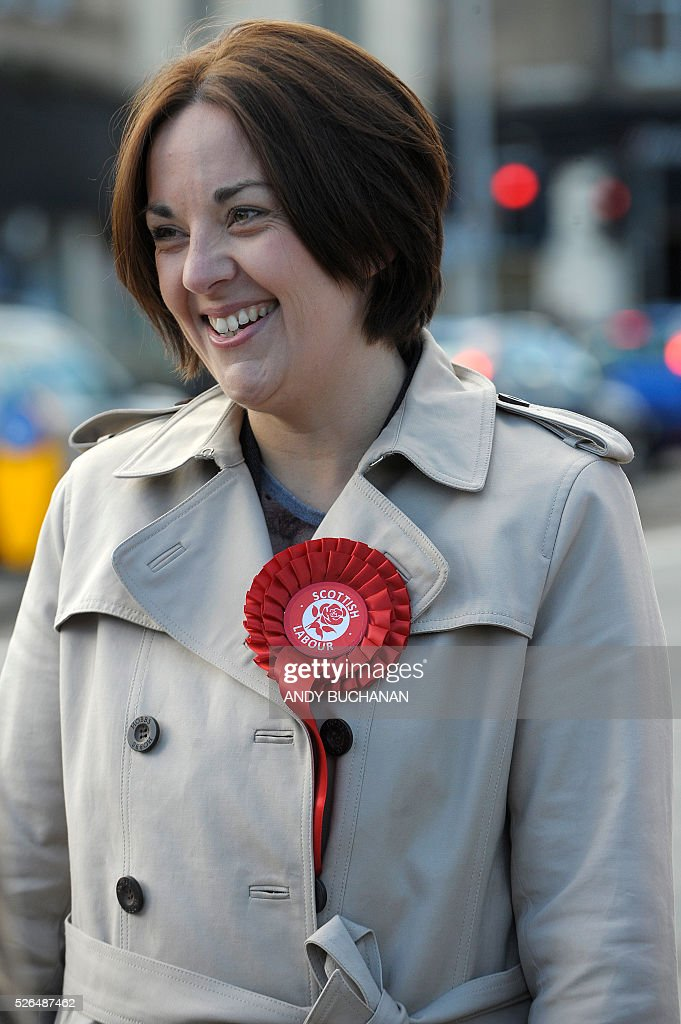 Scottish Labour leader Kezia Dugdale unveils a new election campaign poster on Leith Walk in Edinburgh on April 30, 2015. Scotland will elect a new national assembly on May 5, 2016 with First Minister Nicola Sturgeon's pro-independence Scottish National Party looking to tighten its stranglehold on power. The Conservatives are hoping to pile on the pain for Labour in their former fiefdom by replacing them as Scotland's main opposition. / AFP / Digital / Andy Buchanan
