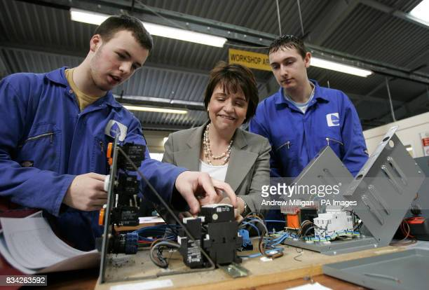 Scottish Labour leader Wendy Alexander with electrical engineers Scott Brown and Lyall Hunter as she launches Labour's Apprenticeship Bill after...