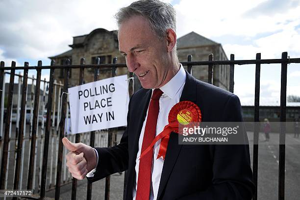 Scottish Labour Party Leader Jim Murphy arrives to vote at Busby Primary School in Clarkston East Renfrewshire in Scotland on May 7 as Britain holds...