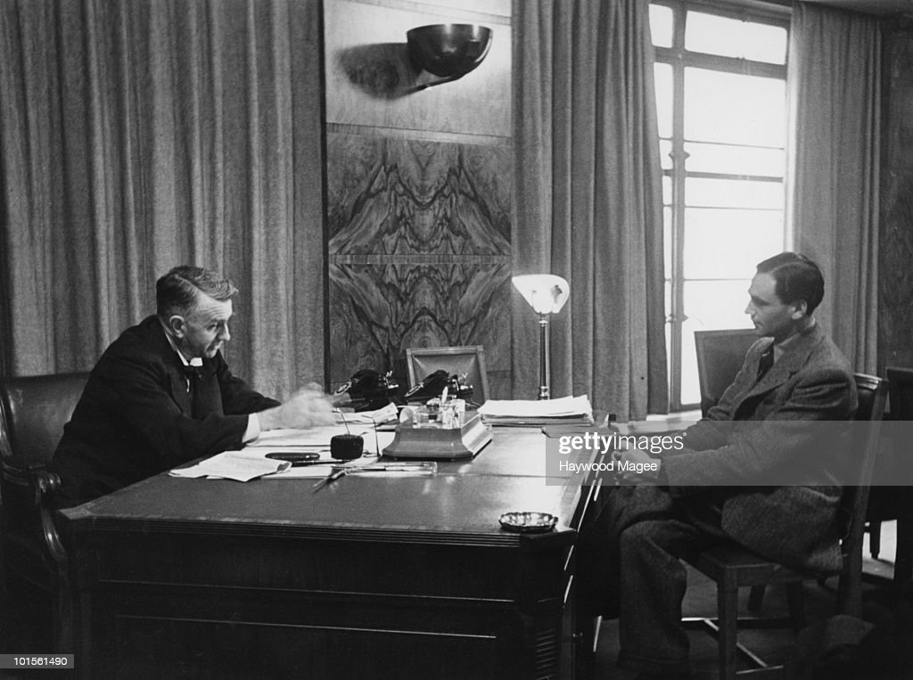 Scottish Labour politician Thomas Johnston (1882 - 1965, left), the Secretary of State for Scotland, 13th March 1943. He is discussing his Hydro-electrification Bill, which proposes the use of Scotland's large water supply to provide electric power for the scattered local population, encouraging industry into the area and combatting unemployment. Original Publication : Picture Post - 1369 - A Power Scheme For The Highlands - pub. 13th March 1943