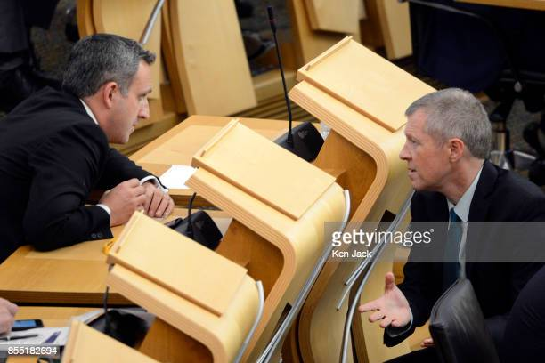 Scottish Liberal Democrat leader Willie Rennie confers with Alex ColeHamilton MSP before First Minister's Questions in the Scottish Parliament on...