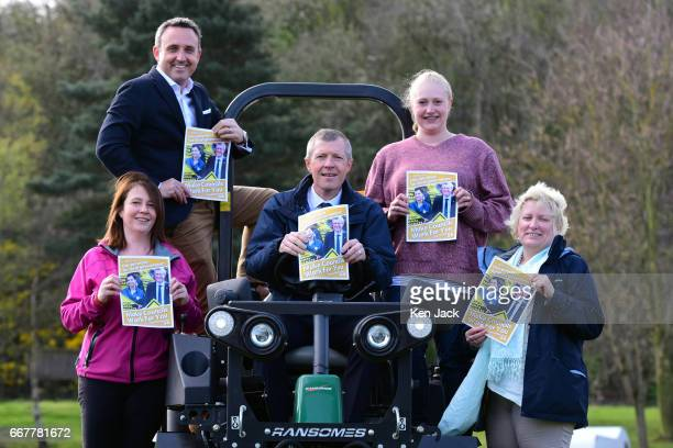 Scottish Liberal Democrat leader Willie Rennie holds up a copy of his party's manifesto for the Scottish local elections surrounded by other party...