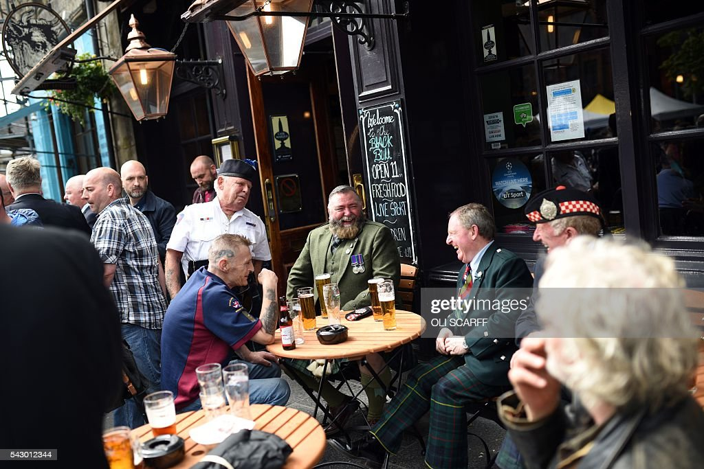 Scottish military veterans drink outside a pub on Armed Forces Day in Edinburgh, Scotland on June 25, 2016. Scotland wants immediate talks with the European Union on protecting its place in the bloc, after Britain's vote to leave the EU, First Minister Nicola Sturgeon said Saturday. Speaking after an emergency meeting of her cabinet, Sturgeon said it had agreed to seek 'immediate discussions with the EU institutions and other EU member states to explore all possible options to protect Scotland's place in the EU.' SCARFF