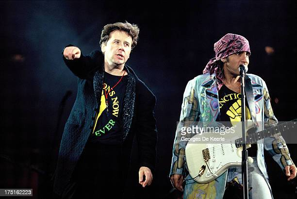 Scottish musician Jim Kerr of Simple Minds and American musician Little Steven perform at a concert held at Wembley Stadium to celebrate the release...