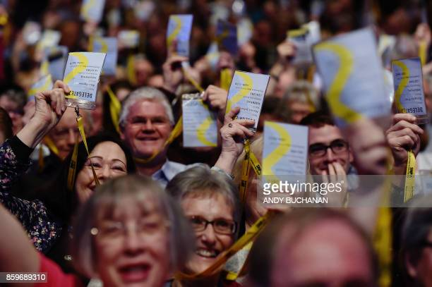 TOPSHOT Scottish National Party delegates gesture during the final day of the Scottish National Party annual conference in Glasgow on October 10 2017...