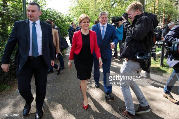 Scottish National Party Leader Nicola Sturgeon and Deputy Leader Angus Robertson leave following a photocall in Victoria Tower Gardens on April 19...