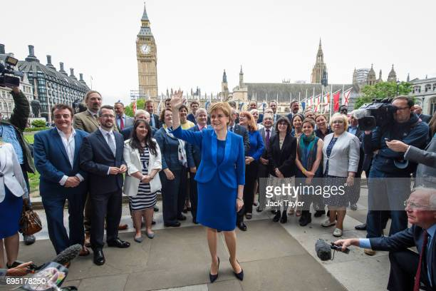 Scottish National Party Leader Nicola Sturgeon waves as she stands in front of SNP MPs elected in the general election during a photocall in...