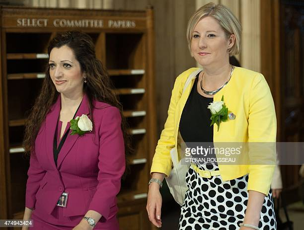 Scottish National Party member of parliament Tasmina AhmedSheikh and Scottish National Party member of parliament Hannah Bardell attend the State...