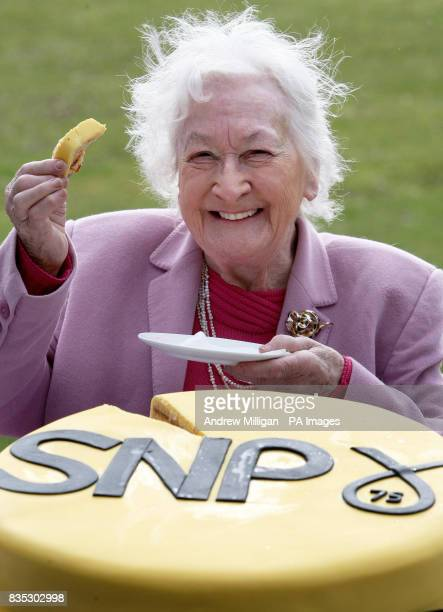 Scottish National Party member Winnie Ewing former MEP and MP has a piece of birthday cake at Stirling University to mark 75th anniversary of the...