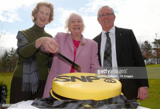 Scottish National Party Stalwart Winnie Ewing former MEP and MP with Bruce Crawford MSP and party member Wilma Murray cut a birthday cake at Stirling...