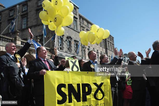 Scottish National Party supporters gather on Edinburgh's Royal Mile for the results of the European election