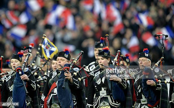 A Scottish pipe band perform ahead of the Six Nations international rugby union match between France and Scotland at the Stade de France northern...