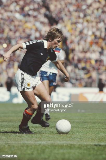 Scottish professional footballer and forward with Liverpool Kenny Dalglish pictured in action for the Scotland national football team during the...
