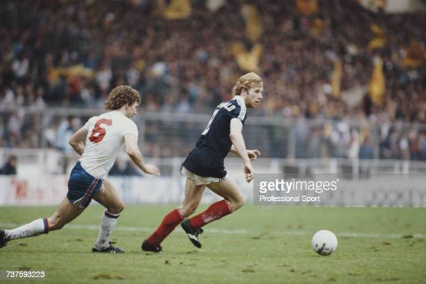 Scottish professional footballer and forward with Tottenham Hotspur Steve Archibald pictured in action for the Scotland national football team making...