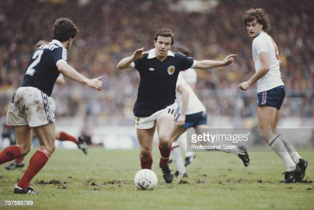 Scottish professional footballer and winger with Nottingham Forest John Robertson pictured in action for the Scotland national football team making a...