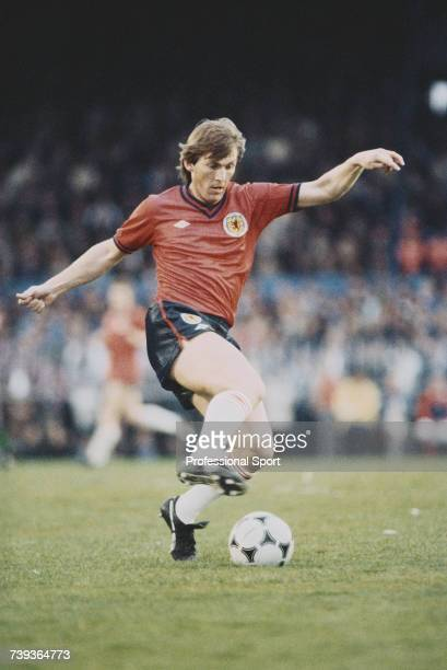 Scottish professional footballer Kenny Dalglish pictured in action playing for the Scotland national football team in the home international British...