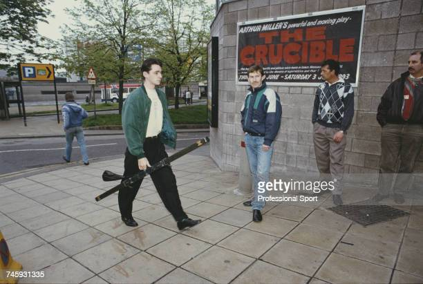 Scottish professional snooker player Alan McManus pictured entering the Crucible Theatre in Sheffield during competition in the 1993 Embassy World...
