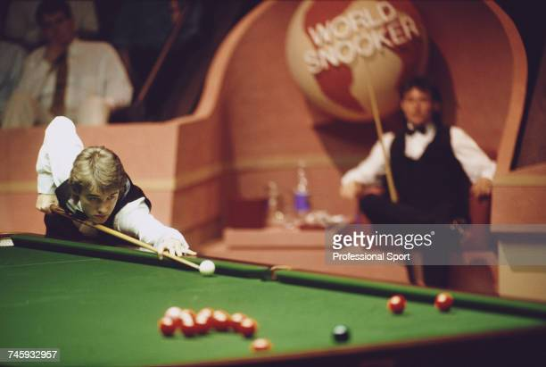 Scottish professional snooker player Stephen Hendry pictured in action against Jimmy White in the final of the 1990 Embassy World Snooker...