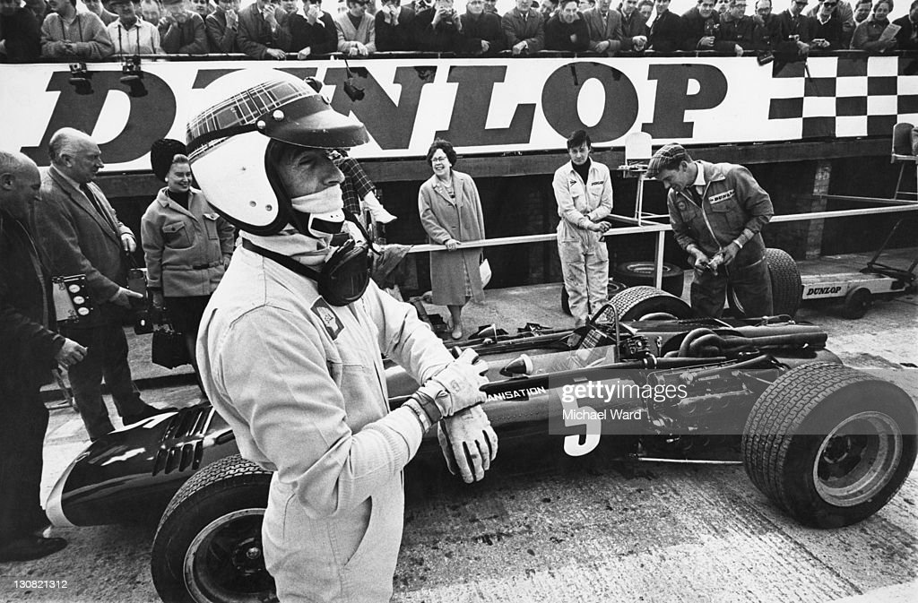 Scottish racing driver <a gi-track='captionPersonalityLinkClicked' href=/galleries/search?phrase=Jackie+Stewart+-+Race+Car+Driver&family=editorial&specificpeople=167276 ng-click='$event.stopPropagation()'>Jackie Stewart</a> at a race, possibly at Brands Hatch, circa 1968.