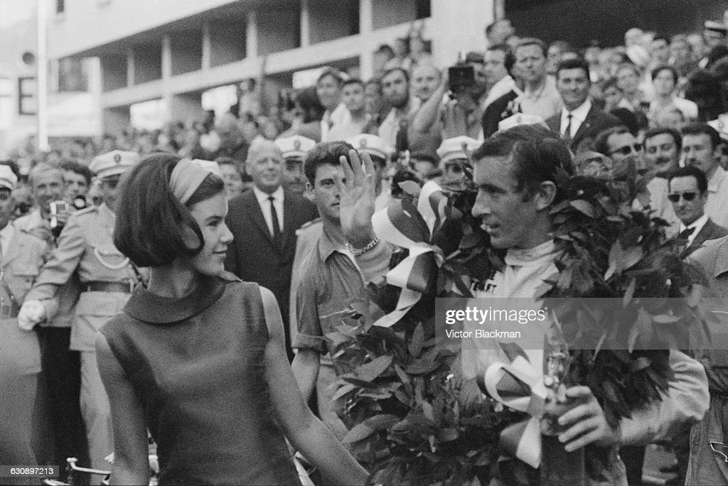 Scottish racing driver <a gi-track='captionPersonalityLinkClicked' href=/galleries/search?phrase=Jackie+Stewart+-+Race+Car+Driver&family=editorial&specificpeople=167276 ng-click='$event.stopPropagation()'>Jackie Stewart</a> (right) with his wife, Helen, after he won the Monaco Grand Prix in a BRM P261, Monte Carlo, 22nd May 1966.