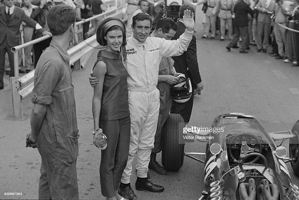 Scottish racing driver <a gi-track='captionPersonalityLinkClicked' href=/galleries/search?phrase=Jackie+Stewart+-+Race+Car+Driver&family=editorial&specificpeople=167276 ng-click='$event.stopPropagation()'>Jackie Stewart</a> (centre) with his wife, Helen, and his BRM P261 car after he won the Monaco Grand Prix, Monte Carlo, 22nd May 1966.