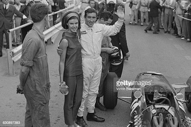 Scottish racing driver Jackie Stewart with his wife Helen and his BRM P261 car after he won the Monaco Grand Prix Monte Carlo 22nd May 1966