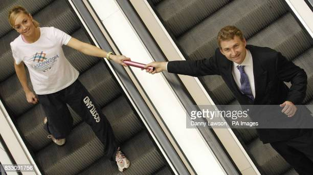 Scottish relay runner Gemma Nicol hands a baton to former Scottish running star Brain Whittle on the escalators in Glasgow's St Enoch Centre to help...