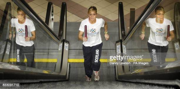 Scottish relay runner Gemma Nicol runs up the escalators in Glasgow's St Enoch Centre to help promote the city's bid to host the 2014 Commonwealth...