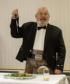 Scottish Robbie Burns Evening - kilted Scotsman leading the tribute