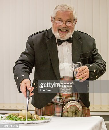 Scottish Robbie Burns Evening  kilted Scotsman leading the tribute : Stock Photo